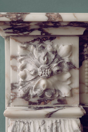 rosette carved detail in fireplace