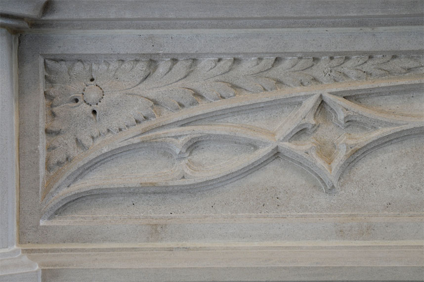 flower detail on fireplace mantel