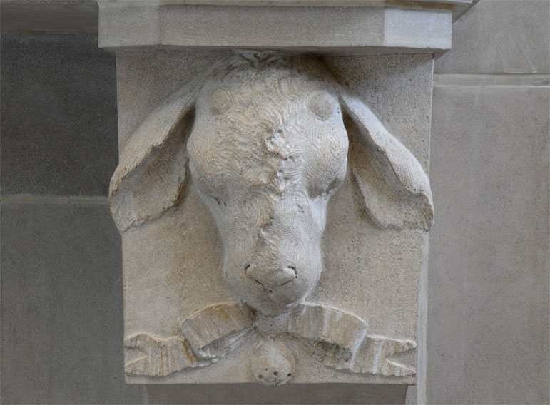 lamb sculpted on fireplace mantel