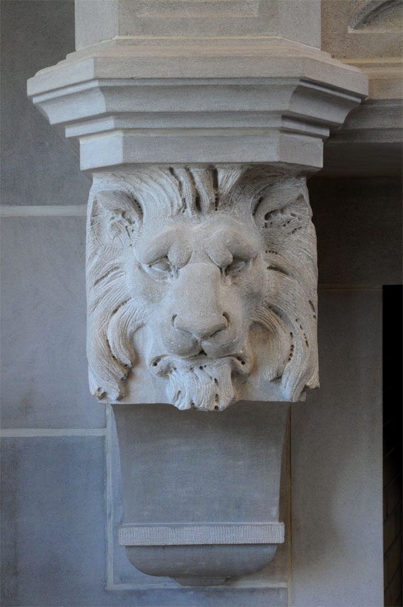 lion head on Gothic fireplace mantel