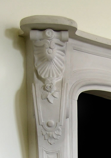 roses carved in louis XIV fireplace mantel
