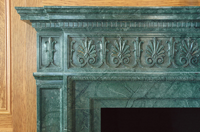 verde marble fireplace mantel detail