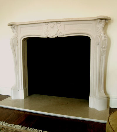 Limestone Louis XIV fireplace mantel