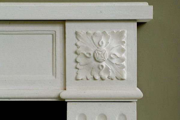 rosette detail on fireplace mantel